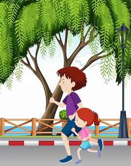 Vader en dochter lopen door park
