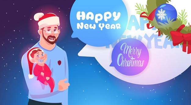 Vader en zoon kerstmuts dragen vrolijk kerstfeest en gelukkig nieuwjaar wenskaart familie