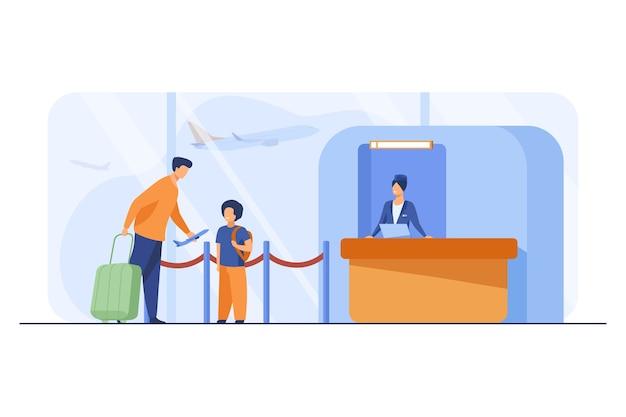 Vader en zoon staan aan balie in luchthaven.