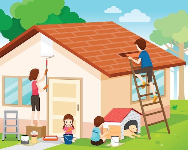 Vader, moeder, zoon en dochter die de buitenkant van het huis herstellen