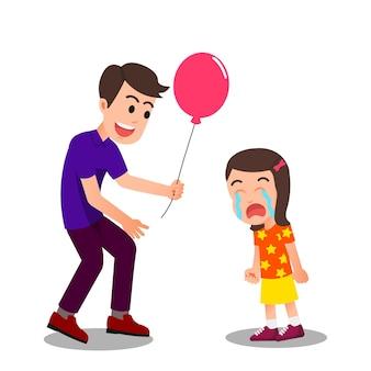 Vader probeert zijn huilende dochter te kalmeren door haar ballonnen te geven