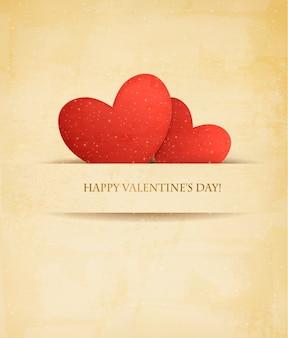 Vakantie vintage valentijnsdag achtergrond. twee rode harten op oud papier.