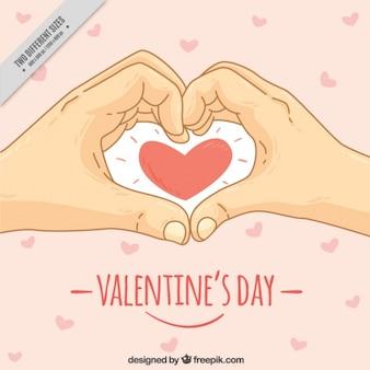 Valentijnsdag achtergrond met de hand getekende handen en hart