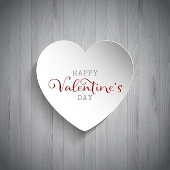Valentijnsdag achtergrond met hart op houten achtergrond