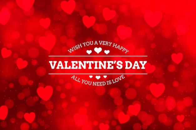 Valentijnsdag achtergrond met wazige elementen Gratis Vector