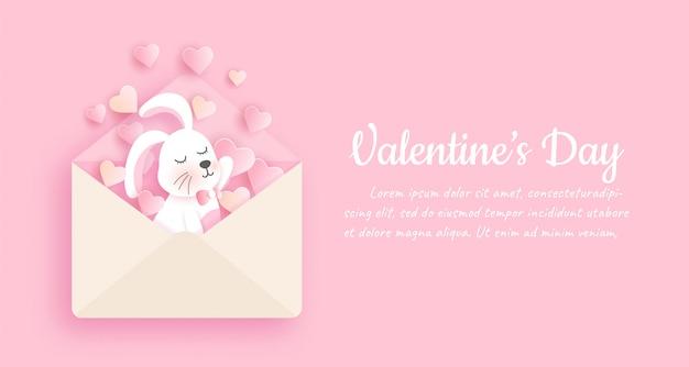 Valentijnsdag banner met schattige konijn in papier gesneden stijl