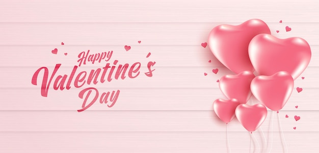 Valentijnsdag banner met vele zoete harten op zachte roze kleur houten achtergrond.