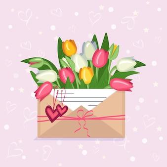 Valentijnsdag feestelijke decoratie tulpen in een ambachtelijke envelop