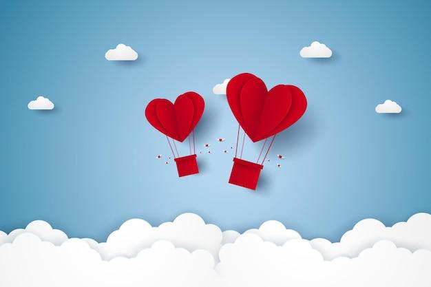 Valentijnsdag illustratie van liefde rood hart hete lucht ballonnen vliegen in de lucht papier kunststijl