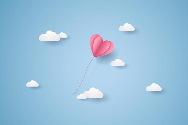 Valentijnsdag, illustratie van liefde, roze hartballon die in de blauwe lucht vliegt, papierkunststijl