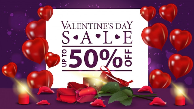 Valentijnsdag korting paarse banner met cadeau en bloemen