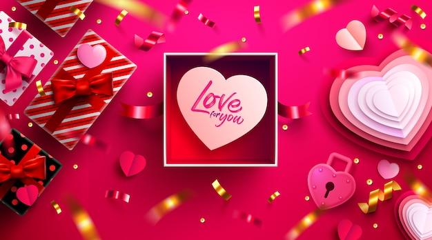 Valentijnsdag met open geschenkdoos, liefje en mooie items.