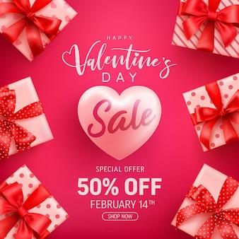 Valentijnsdag sale 50% korting op banner met schattige geschenkdoos op roze