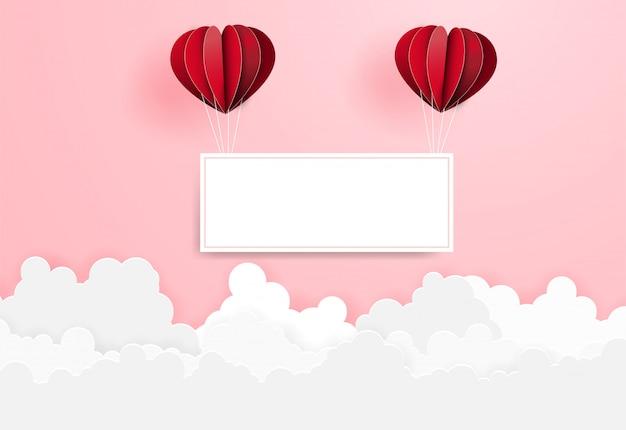 Valentine-dag hete luchtballon die op wolk vliegen.