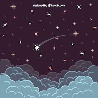Vallende ster boven de wolken