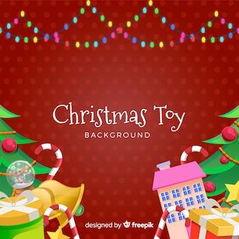 Van het achtergrond kerstmisspeelgoed kleurrijke slinger