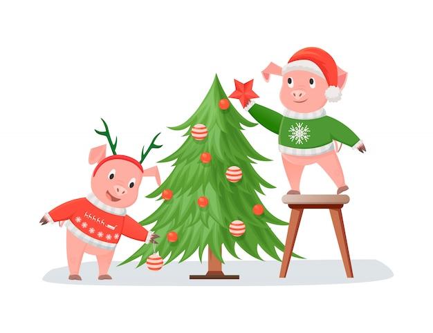 Varkens in gebreide truien versieren kerstboom