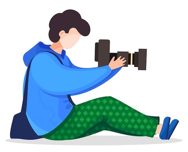 Vector cartoon stijl karakter fotograaf zitten en houden digitale camera.