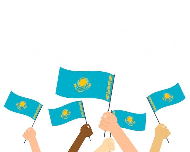 Vector illustratie die van handen de vlaggen van kazachstan houdt