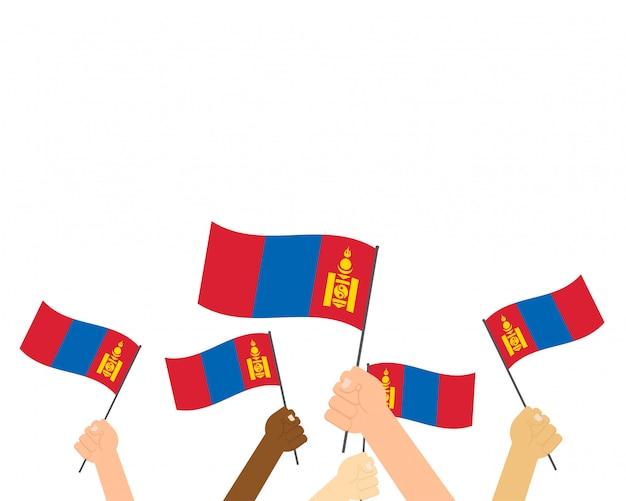 Vector illustratie die van handen de vlaggen van mongolië houdt