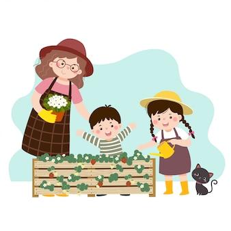 Vector illustratie van een cartoon moeder en haar twee kinderen kijken naar de aardbeienplant in een verhoogd tuinbed.