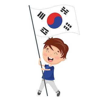 Vector illustratie van kid holding korea vlag
