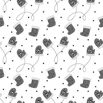 Vector kerst scandinavisch naadloos patroon met sokken en wanten. winter abstracte hand getekende lijnen.