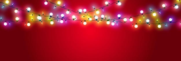 Vector kerstslinger op een rode achtergrond lichte lichtslinger veelkleurige lichte kerst