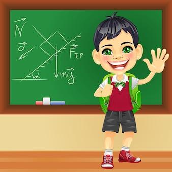 Vector lachende schooljongen in de buurt van blackboard
