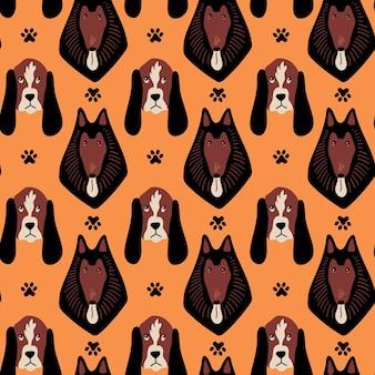 Vector naadloos patroon met basset hound collie en pootafdrukken op oranje achtergrond