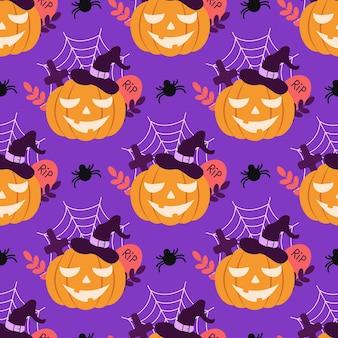 Vector naadloos patroon met een pompoen in een hoed en een spin in een vlakke stijl op een paarse achtergrond