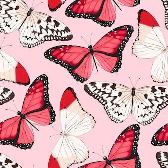 Vector naadloos patroon met rode en witte vlinders op een roze achtergrond
