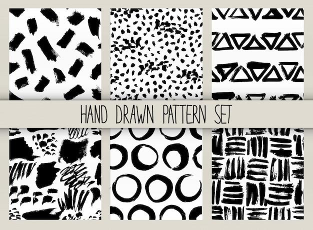 Vector naadloze patroonreeks. herhaalbare textuur met zwarte inkt getrokken lijnen collectie