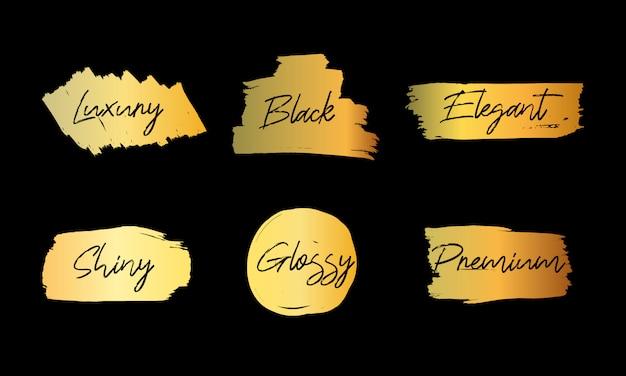 Vector penseelstreek dozen gouden kleurenset