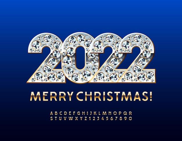 Vector premium wenskaart merry christmas 2022 met briljante decoratie gouden alfabet set