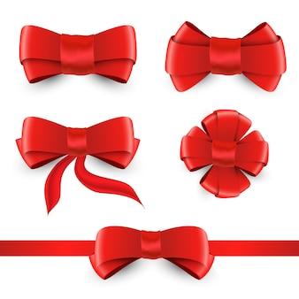 Vector rode boog en lint. glanzende rode satijnen strikken set geïsoleerd op een witte achtergrond voor uw ontwerp