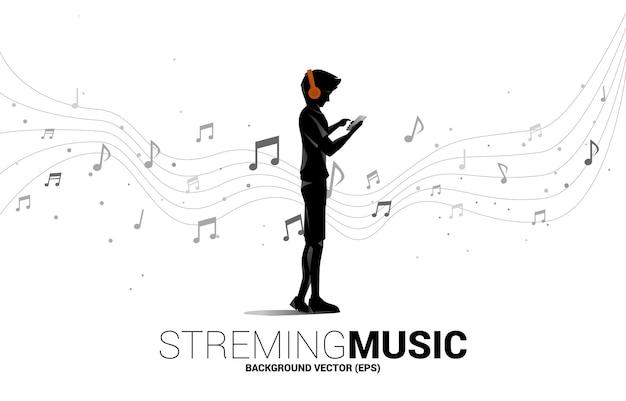 Vector silhouet man met mobiele telefoon en hoofdtelefoon en muziek melodie noot dansende stroom. concept achtergrond voor lied en concert thema.