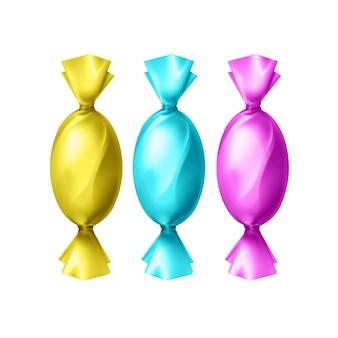Vector snoepjes in lege kleurrijke gele, cyaan, magenta folie wrapper bovenaanzicht geïsoleerd op een witte achtergrond