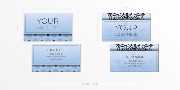 Vector visitekaartjes in blauw met luxe zwarte ornamenten. visitekaartjeontwerp met vintage patronen.