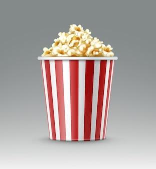 Vector wit en rood gestreepte emmer popcorn pitten close-up zijaanzicht geïsoleerd op een grijze achtergrond
