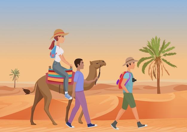 Vectorillustratie die van de mens met gids en vrouwen berijdende kameel lopen in woestijn.