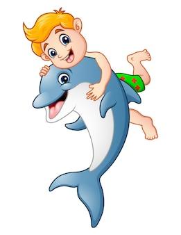 Vectorillustratie van cartoon jongen spelen met dolfijn