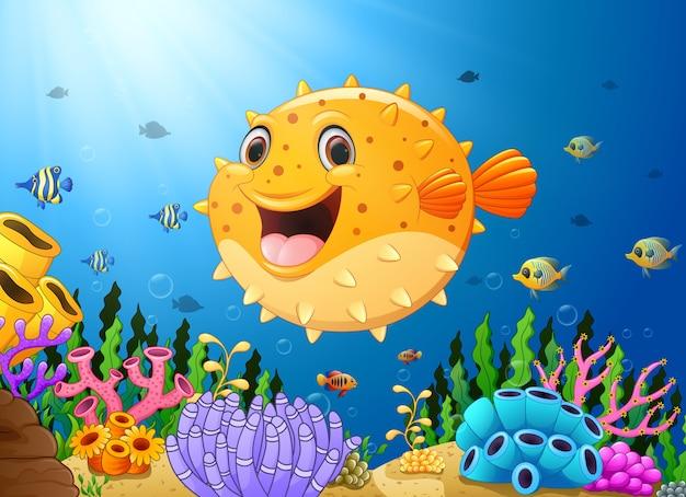 Vectorillustratie van cartoon puffer vis met zeeleven