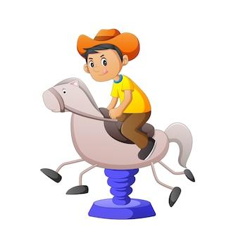 Vectorillustratie van een cowboy die een stuk speelgoed paard speelt