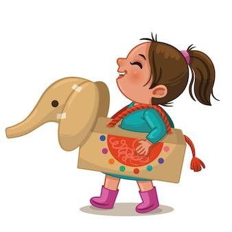 Vectorillustratie van een klein meisje dat speelt met haar eigen gemaakte speelgoed