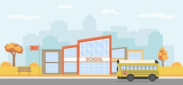 Vectorillustratie van een modern schoolgebouw met een schoolbus.