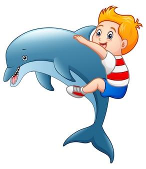 Vectorillustratie van kleine jongen cartoon met dolfijnen