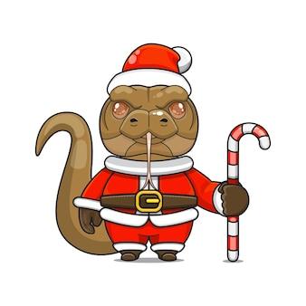 Vectorillustratie van schattige monster comodo-mascotte die een kerstmankostuum draagt met een snoepriet?