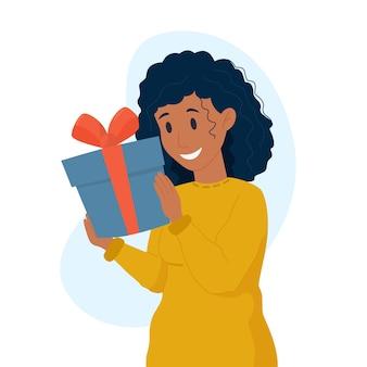 Vectorillustratie zwarte vrouw met een cadeau voor kerstmis en nieuwjaar