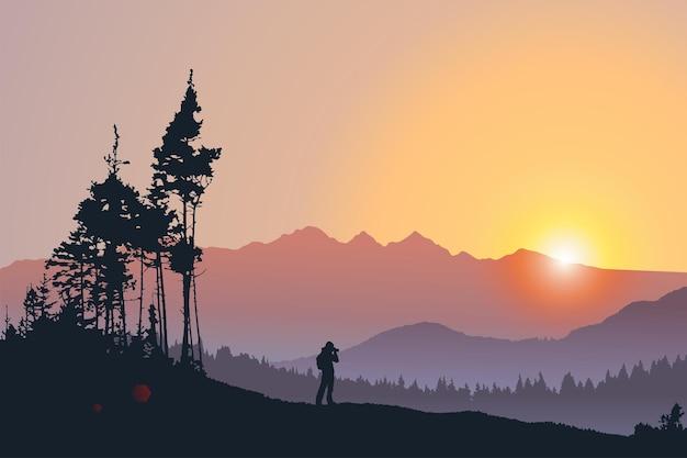 Vectorlandschapssilhouet van een eenzame reiziger die foto neemt van bergen en bos bij zonsondergang